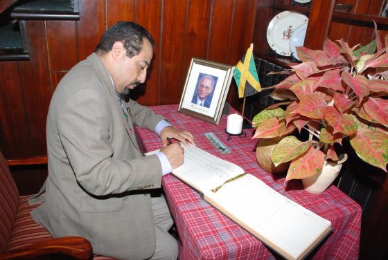 ACS Official signs Condolence Book at the Jamaican High Commission